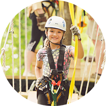 Girl on zip line course