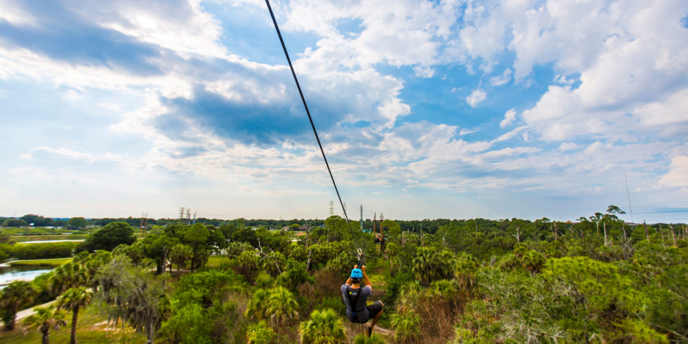 Man on a zip line course in Tampa Bay