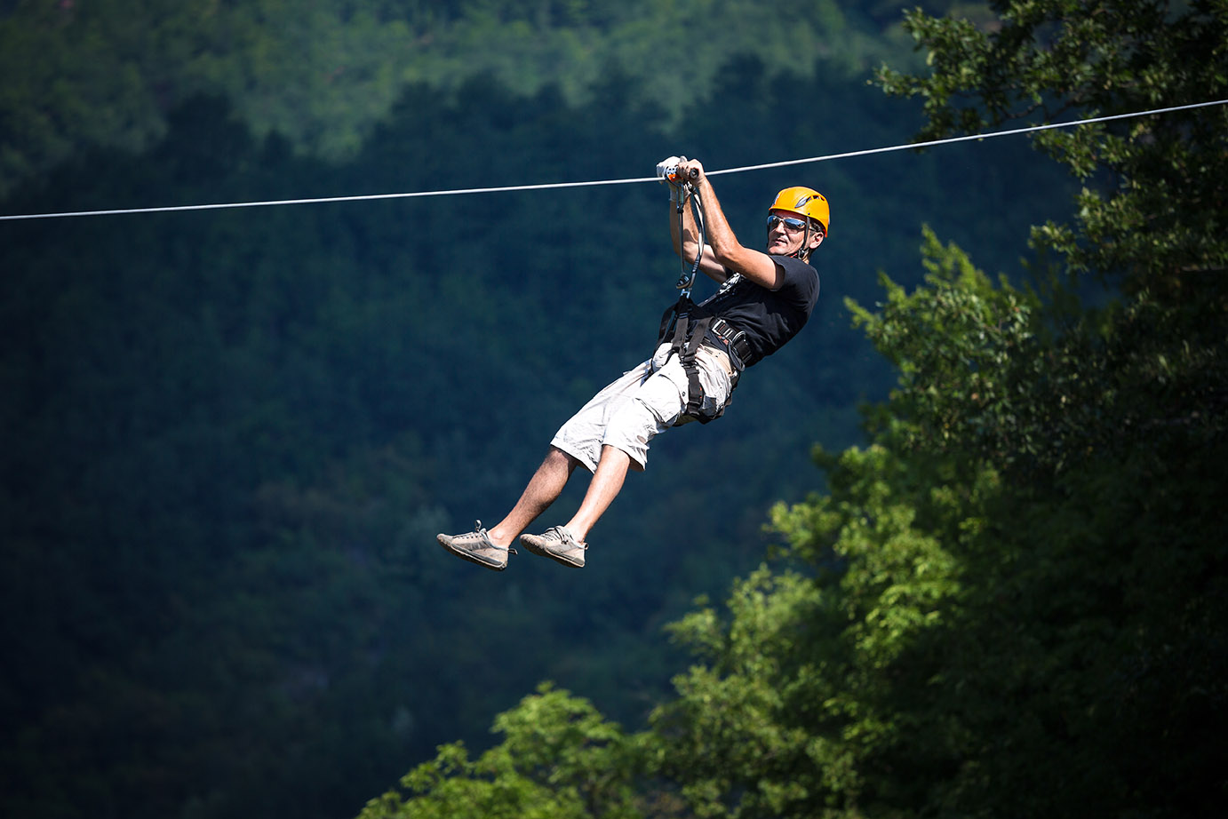 Man enjoys nature on canopy tours
