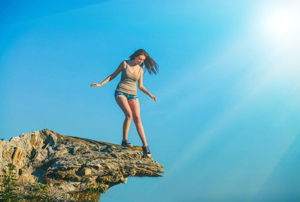 Woman standing on the edge of a cliff